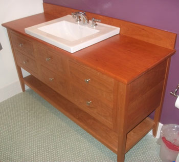 double height apron open style vanity with six drawers