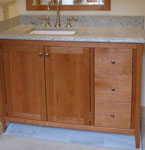 Shaker Style vanity with two doors and a stack of 3 drawers