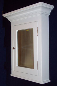 Surface mounted medicine cabinet with a crown molding top