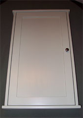 Narrow surface mounted medicine cabinet with a shaker flat panel door