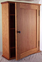Surface mounted shaker style medicine cabinet with a shaker flat panel door