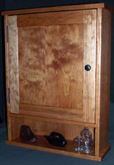 Surface mounted shaker style medicine cabinet with an open shelf