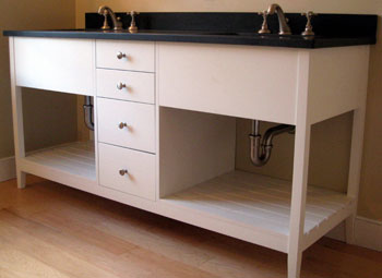 open vanity with stack of centered drawers
